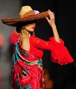 Spanish model Eva Gonzalez presents a creation by Rocio Peralta during the first day of the SIMOF (International Flamenco Fashion Show) in Sevilla, on January 31, 2013. AFP PHOTO/ CRISTINA QUICLER